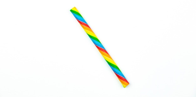 Candy stick for kids on white isolated background, macro close up. high quality photo