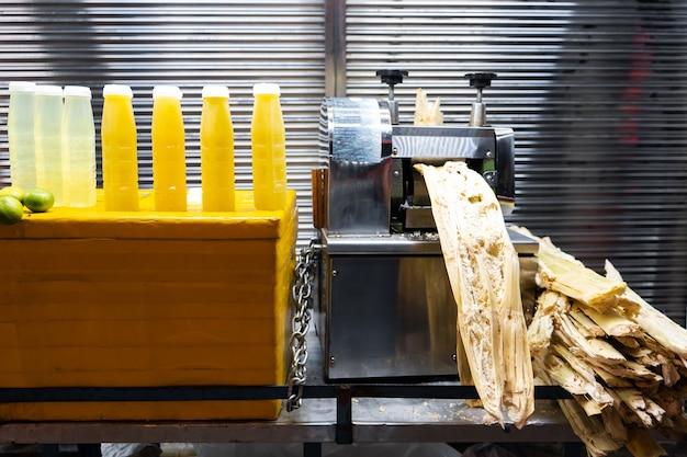 Cane making juice machine at the bar