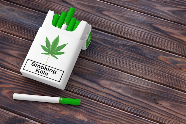 Cannabis cigarettes pack concept with one cannabis cigaretta on a wooden table background. 3d rendering