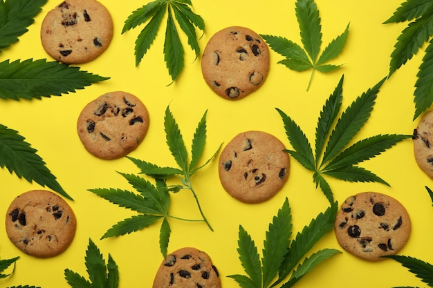 Cannabis cookies and leaves on yellow
