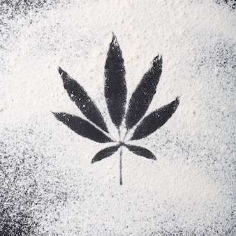 Cannabis food concept. sprinkled flour on the table