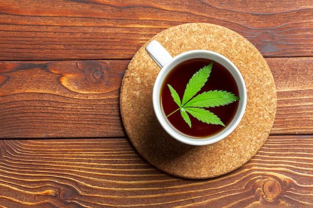 Cannabis herbal tea and marijuana leaves