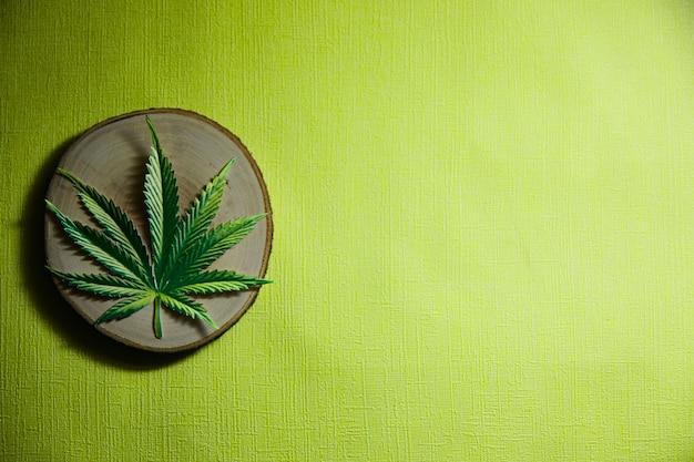 Cannabis leaf on a wooden saw. copy space