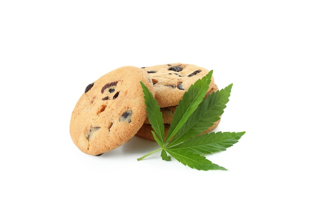 Cannabis leaves and cookies isolated on white background