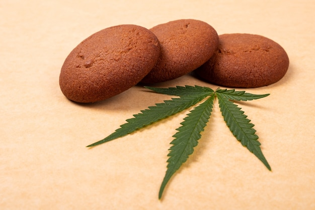 Cannabis sweets,marijuana cookie and green leaf close up.