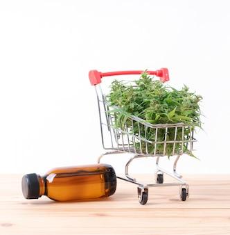 Cannabis with cannabidiol extract on table