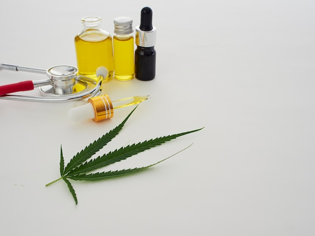 Cannabis with extract oil in a bottle and stethoscope