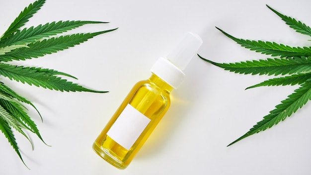 Cannabis with extract oil in a bottle