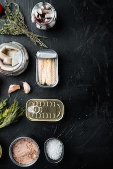 Рыбные консервы, набор лучших американских консервов, на черном