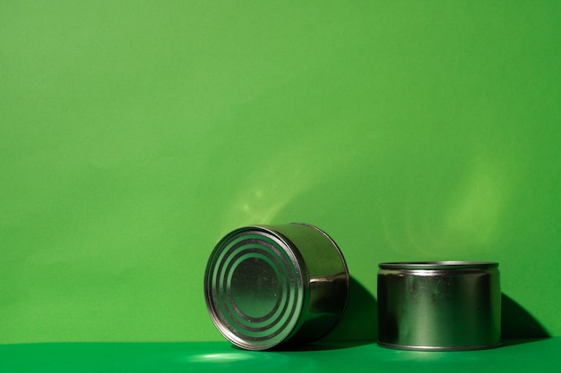 Canned food tin on green background