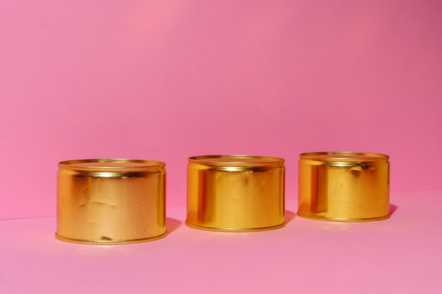 Canned food tin on pink studio background