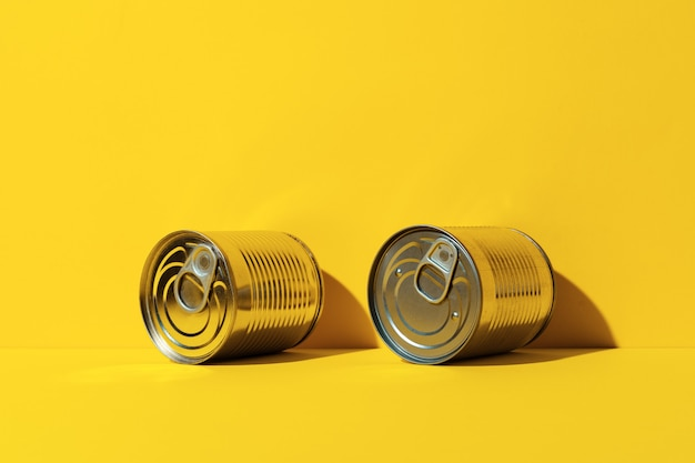 Canned food tin on yellow background
