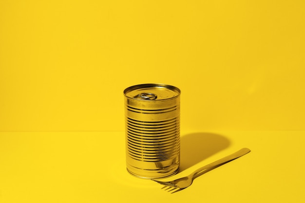 Canned food tin on yellow studio background