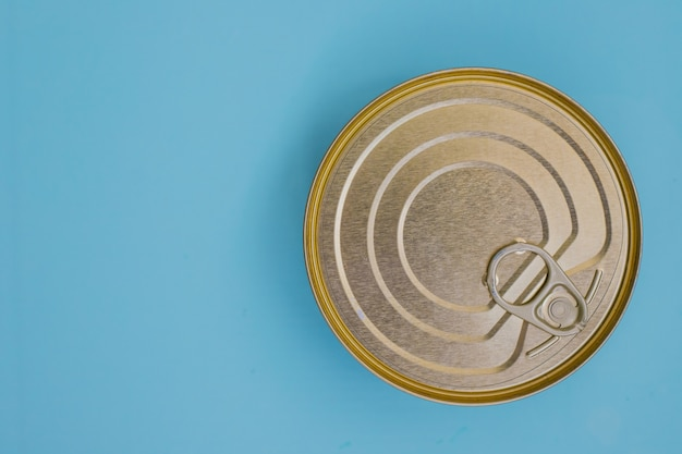 Canned goods on a blue background.food storage.food for donations.food aid.food delivery.