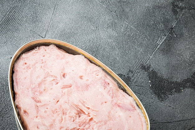 Canned ham set, on gray stone table background, with copy space for text