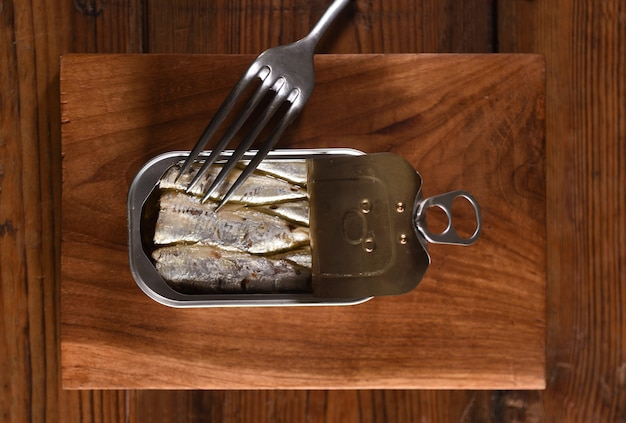 Canned sardine on wooden table