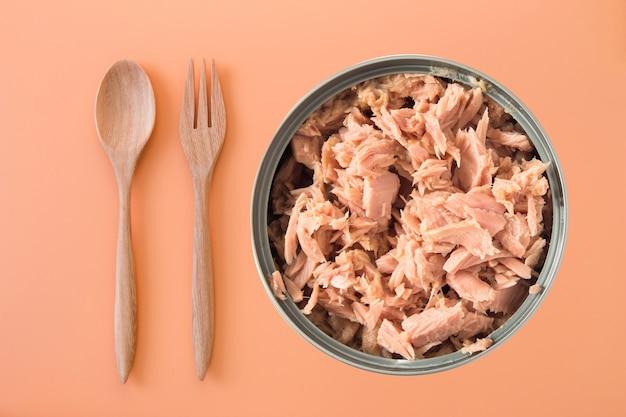 Canned tuna isolated on orange background