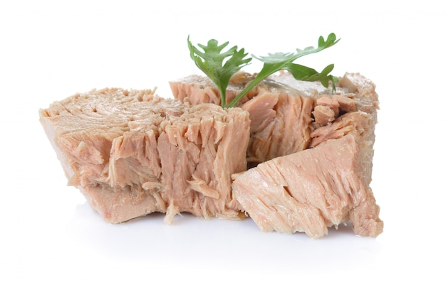 Canned tuna on white surface