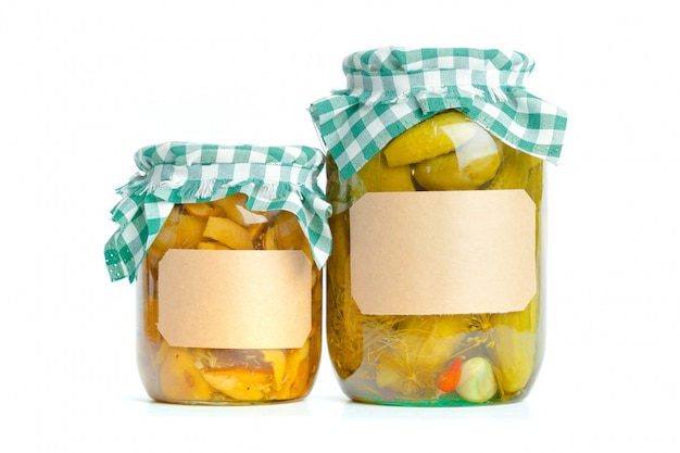 Canned vegetables in glass jars isolated on white background