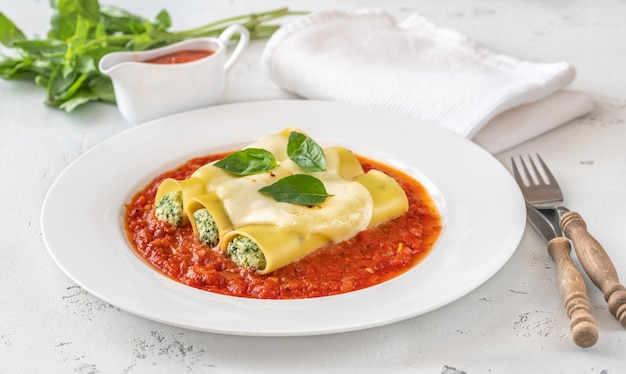 Cannelloni pasta stuffed with ricotta and spinach with tomato sauce