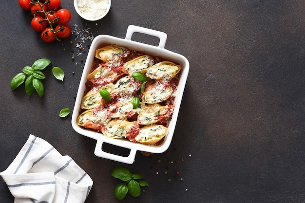 Cannelloni with ricotta and spinach baked in tomato sauce with parmesan.baked pasta with ricotta.