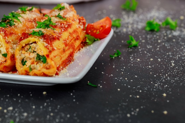 Cannelloni with spinach and ricotta baked in sauce
