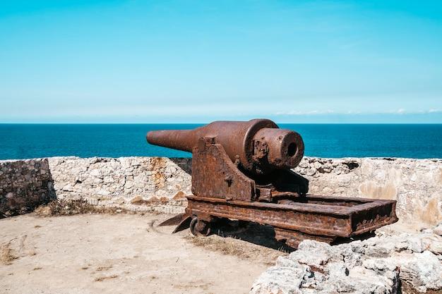 Cannons at fort of saint charles or fortaleza de san carlos de la cabana, cuban flag in havana,