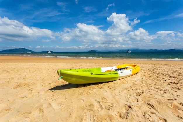 Canoe on the beach at sunshine day