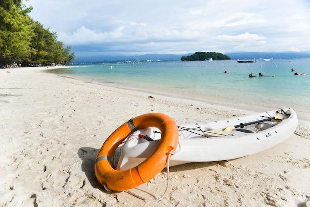 Canoe on the beach with float