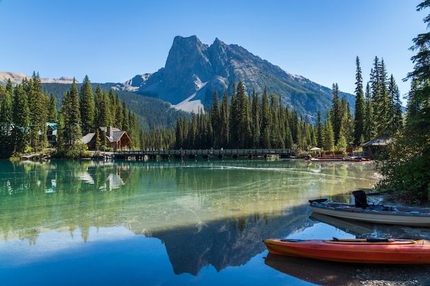 Canoeing on emerald lake in summer day