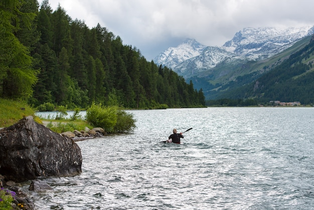Canoeist in the lake of the alps