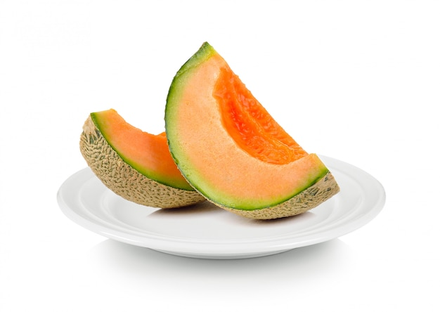 Cantaloupe melon in white plate on white space
