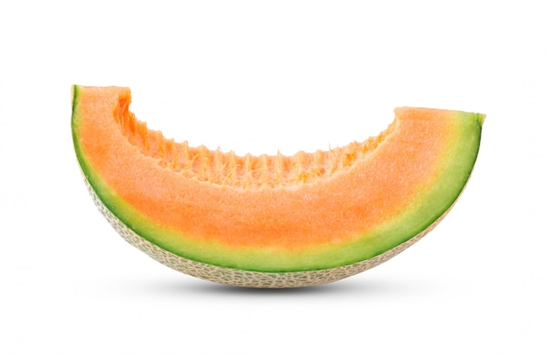 Cantaloupe melon on white wall .
