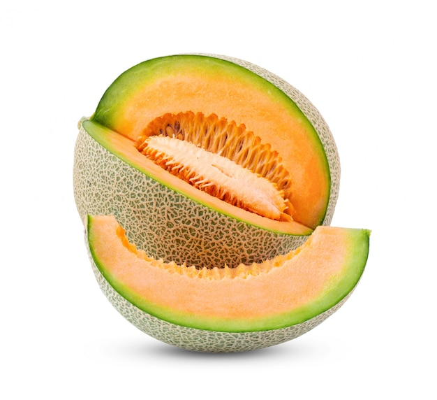 Cantaloupe with seeds on white wall