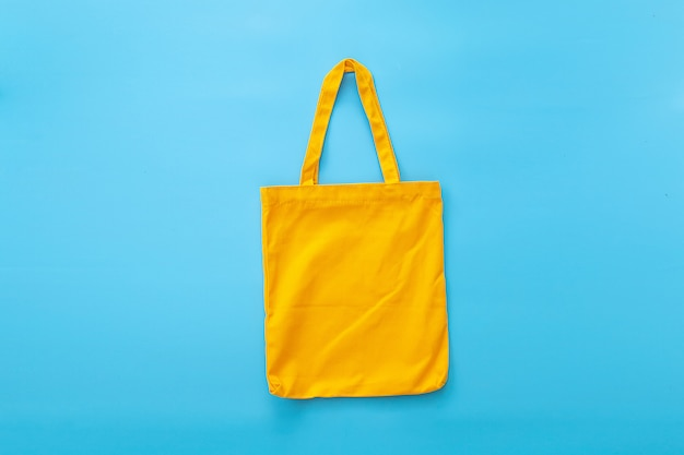 Canvas bag or cloth bag made from natural materials with blue background. ideas for reducing plastic bags.