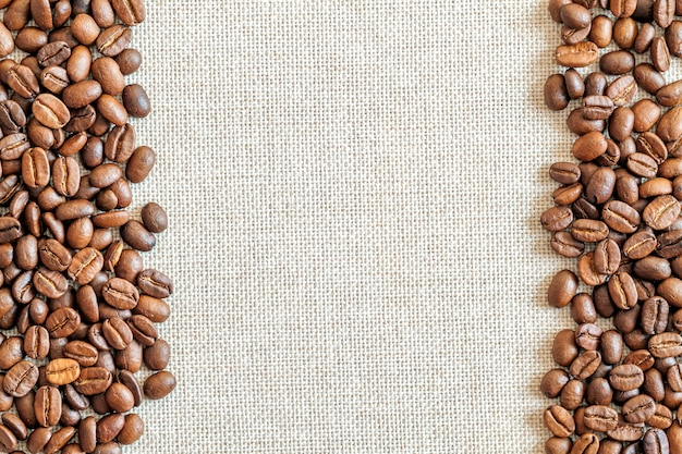 Canvas and coffee beans background.
