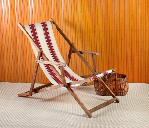 Canvas deck chair and wicker basket