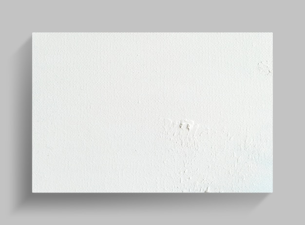 Canvas frame on gray wall background with soft shadow.