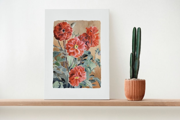 Canvas wall art on a wooden shelf with cactus