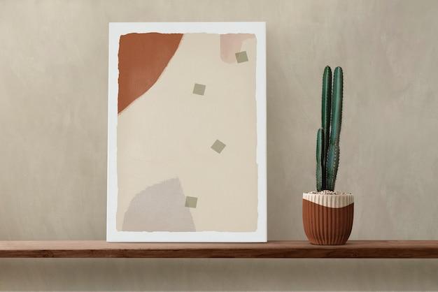 Quadro su tela su mensola in legno con cactus