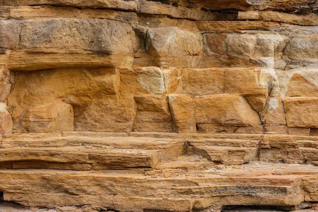 Естественная коричневая canyan предпосылка стены текстуры скалы.