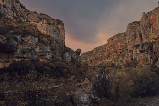 Canyon crossed by a river at sunset