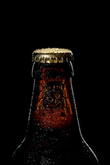 Cap of beer bottle closeup on a black background