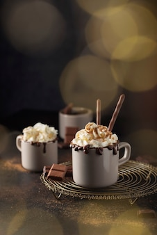 A cap of hot chocolate with whipped cream and cinnamon