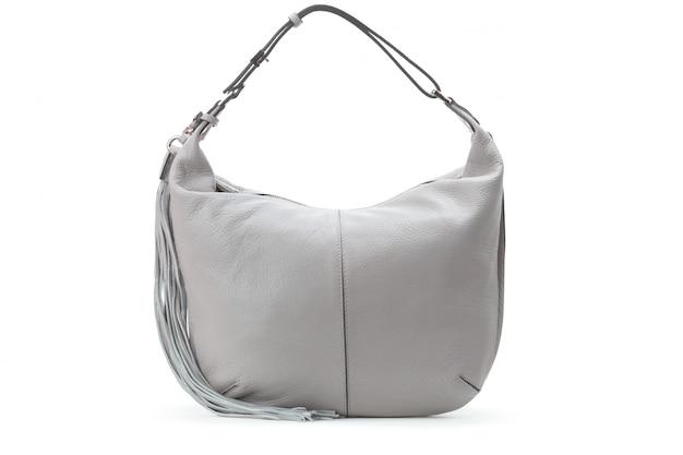 Capacious female purse handbag over a white background