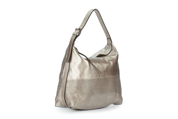 Capacious female purse handbag over a white