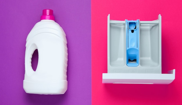 Capacity of washing machine for powder, bottle of washing gel on colored background. top view, flat lay