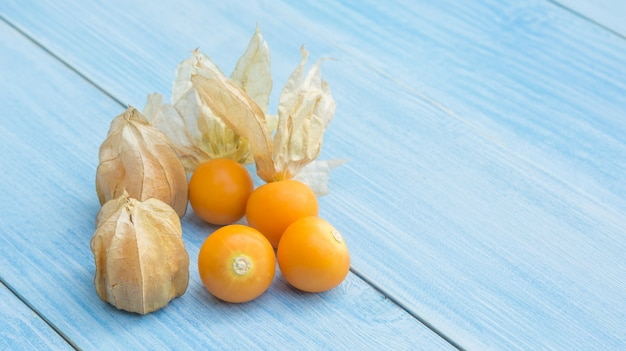 Cape gooseberry on a blue wooden table.