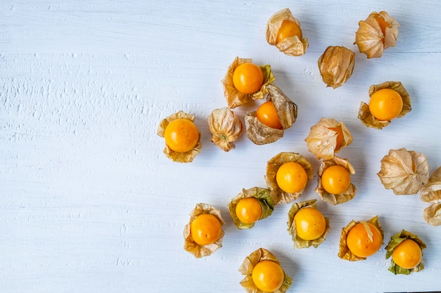 Cape gooseberry fruit on a white wooden board