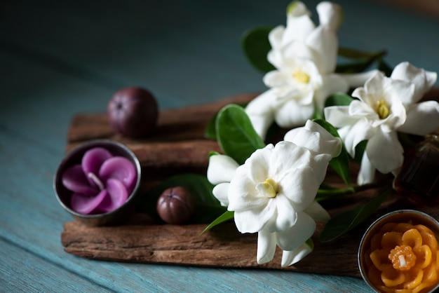 Cape jasmine flowers on an old wooden.